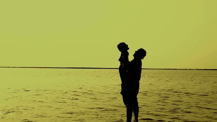 Silhouette of Father and Son at Beach