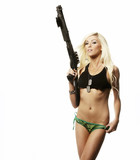 Beautiful sexy woman with gun