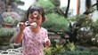 Cute little girl having fun with bubbles