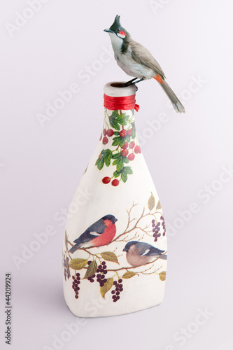 Bird on a decoupage bottle