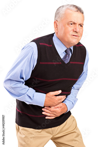 Mature man overwhelmed with a pain in the stomach
