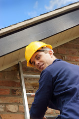 Builder or roofer climbing a ladder