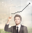 Businessman drawing a graph -growth