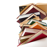 opened book, lying on stacked books on white background