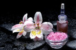 with orchid and bath salt in bowl with stones and massage oil