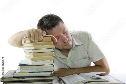 Man sleep and reading book in the library
