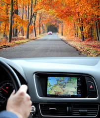 Travel by car with gps in autumnal scenery
