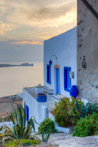 Fototapeta Traditional house at sunset, Milos island, Cyclades, Greece