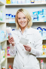 Happy Pharmacy chemist woman in drugstore