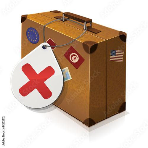 Valise ancienne et son étiquette refusée