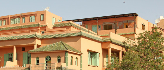 Beautiful streets of Marrakesh with its famous red houses and pa