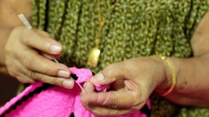 female elder knitting hand close up