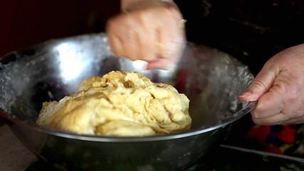 Woman kneading a delicious sponge cake