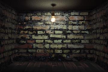 Habitación oscura con paredes de ladrillo