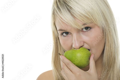 Woman with half eaten pear