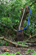 Blue bucksaw with yellow handle