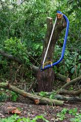 Blue bucksaw with yellow handle