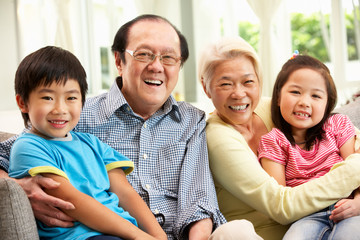Portrait Of Chinese Grandparents With Grandchildren Relaxing