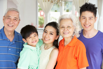 Portrait Of Multi-Generation Chinese Family Relaxing At Home