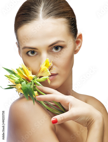 portrait of brunette spa woman with flower
