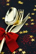 Christmas cutlery. Spoon, fork and knife on a starry background
