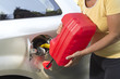 Adding fuel in car with plastic can