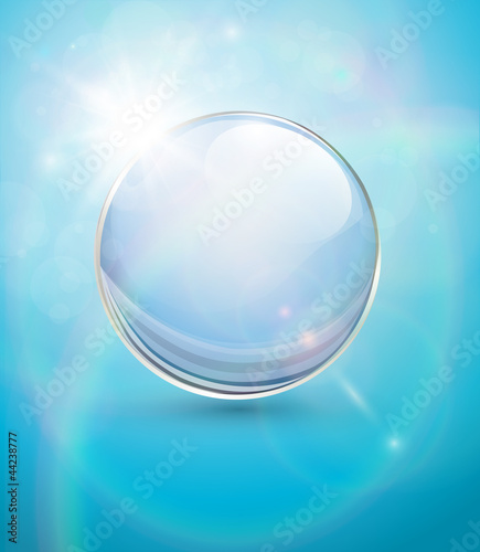 Sunny blue background, with transparent sphere