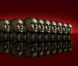 Metallic heads lined up on a reflective black surface