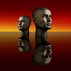 Two manneqiun heads on a dark reflective surface
