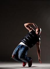 stylish dancer over dark background
