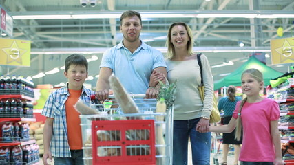 Smiling family of four enjoying shopping together