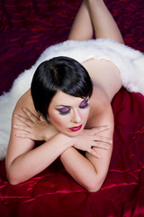 gourgeos nude female brunette flapper wearing fur over red silk