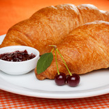 Croissant with cherry jam