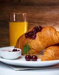 Breakfast with croissant and juice