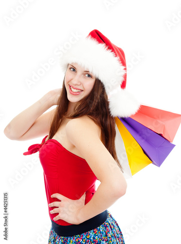 pretty girl in christmass hat with colorful bags