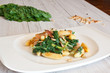 fresh salad with chard noodles and pine nuts on wooden table