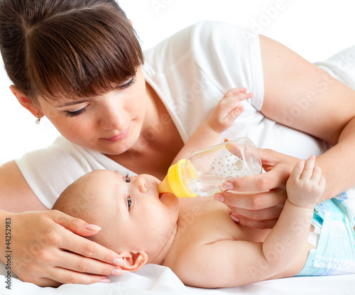 young mother feeding her adorable baby