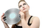 Bright portrait beautiful young girl with a vinyl record poster