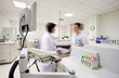 Blurred laborants figures in laboratory