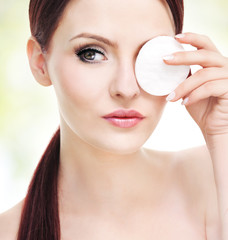 Make up removal, beautiful young adult woman with cotton pad