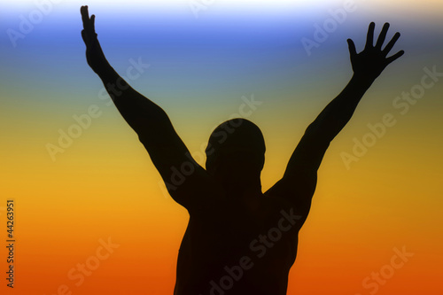 Silhouette of a man on a rainbow background