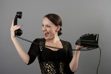 cute young smiling woman with  vintage phone