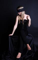 Fashion photo of beautiful woman with black veil
