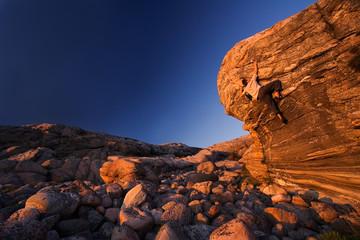 Climber reaching towards the top