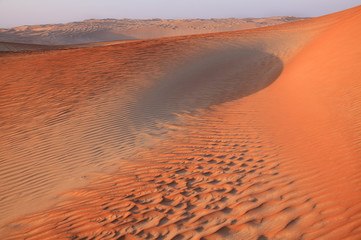 Dusk falling in the huge sand dunes of the United Arab Emirates