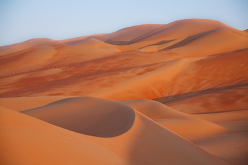 Sunset in the beautiful dunes of the United Arab Emirates