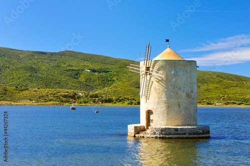 Old windmill in harbor of orbetello