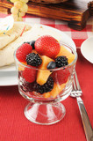 Fruit and berries with breakfast burritos