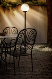Fototapeta Dining table and chairs and the lamp in a restaurant