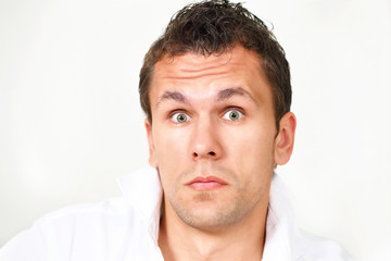 Astonished young man with wide-eyed look